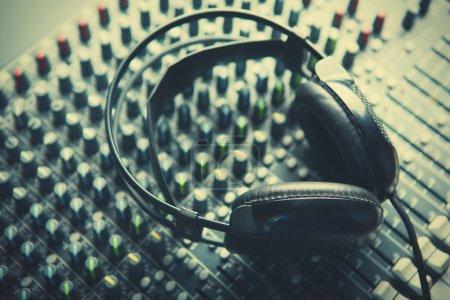 Headphones on soundmixer close-up