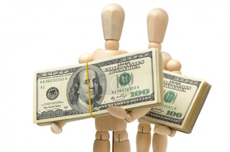 Dollars bank notes in wooden puppets hands