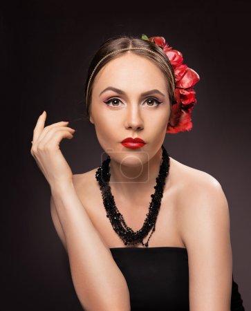 Portrait of glamorous brunette girl over dark background with bu