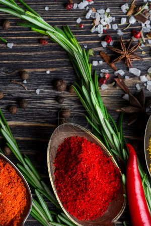 Spices over wooden background