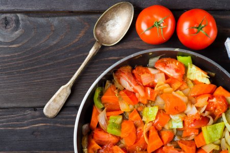 Stewed vegetables in cooking pan