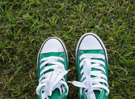 Photo for Green shoes on the grass with copy space - Royalty Free Image