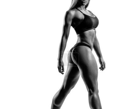beautiful fitness woman posing on studio background