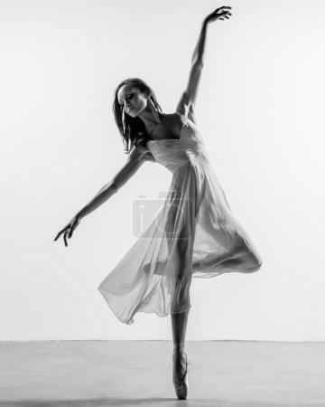 balerina posing in studio