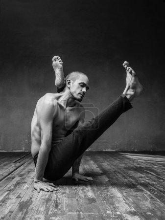 yoga posing in studio