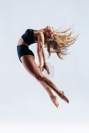 Photo for Young beautiful modern style dancer posing on a studio background - Royalty Free Image