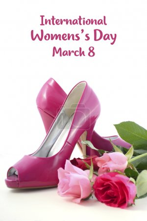 Photo for Feminine pink high heel shoes with roses on white wood table for International Womens Day, March 8. - Royalty Free Image