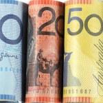 Rolls of Australian cash money with five, ten, twe...