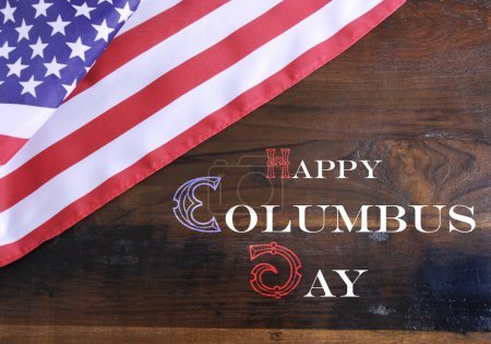 Happy Columbus Day greeting message text on dark rustic recycled wood