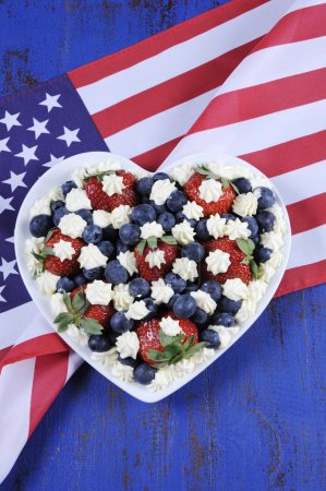Patriotic red, white and blue berries with fresh whipped cream stars