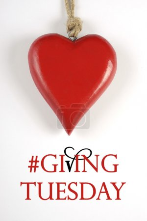 Photo pour Giving Tuesday philanthropy day after Black Friday shopping message sign with red heart and sample text. Vertical. - image libre de droit