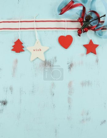 Modern Christmas red and white ornaments on aqua blue vintage wood background.