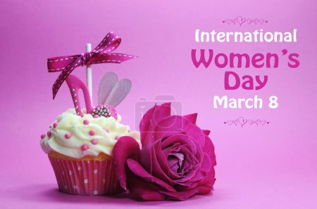 Photo for Happy International Womens Day greeting with pink rose and cupcake with high heel shoe on pink background with sample text. - Royalty Free Image