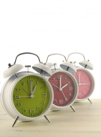 Daylight Saving Time concept with three colorful r...