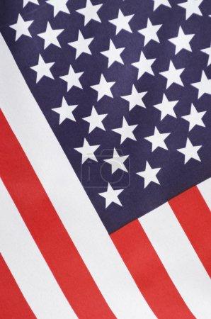 USA Stars and Stripes Flag on Dark Wood, close up,...