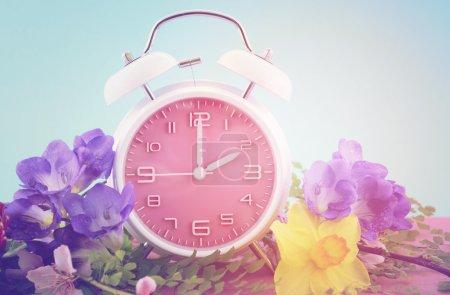 Springtime daylight saving time concept with pink ...