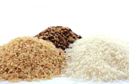 Stacks of raw gluten-free rice cereal ingredient, ...