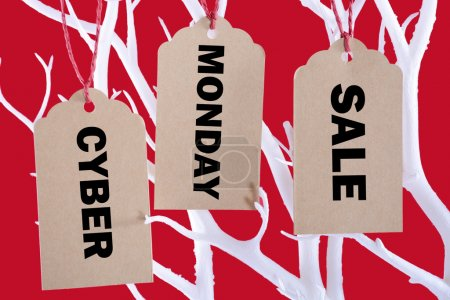 Cyber Monday Sale tickets hanging from tree branch