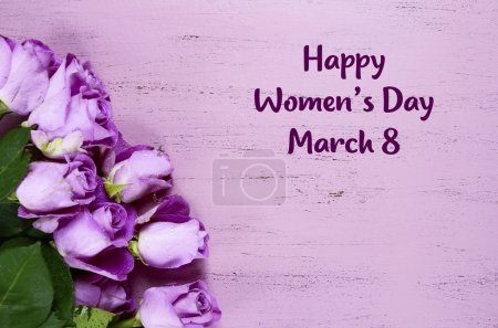 Photo for International Womens Day purple roses on purple wood background with copy space and sample text. - Royalty Free Image