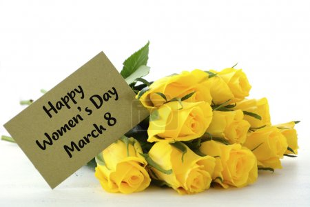 Photo for International Womens Day gift of yellow roses with greeting card and sample text. - Royalty Free Image