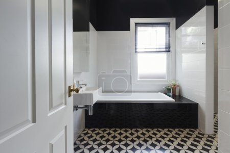 Designer bathroom renovation black and white floor tiles horizon