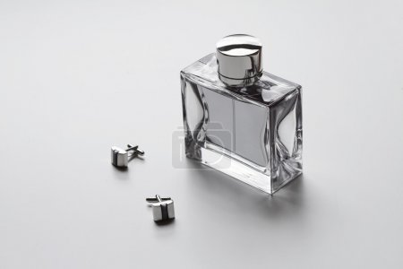 Horizontal mens cologne and cufflinks