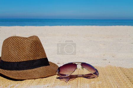 Photo for Summer hat and sunglasses on a beach - Royalty Free Image