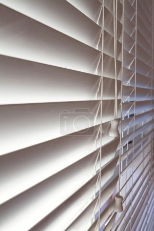 Close up of white venetian blinds