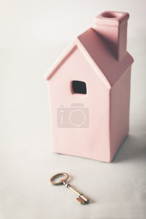 Toy pink house with gold key