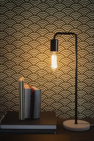 Edison filament table lamp and books home interior