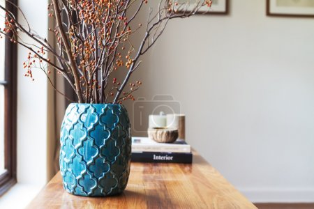 Horizontal moroccan teal vase with clear space for text on white