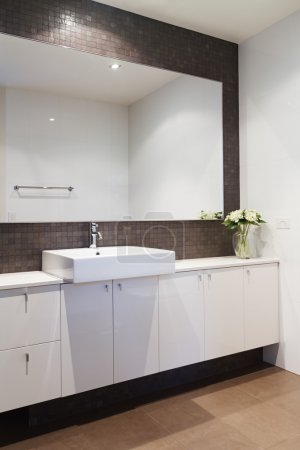 Clean white bathroom with mosaic rustic splashback