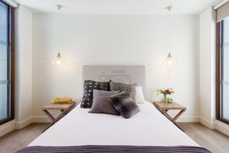 Beautiful hamptons style bedroom decor in luxury home interior