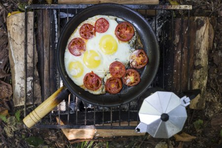Camping cooking breakfast.