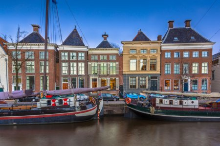 Photo for Historic boats and buildings at Hoge der Aa quay in Groningen city center, Netherlands - Royalty Free Image