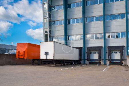 Photo for Red and White Trailer at a Docking Bay of a distribution centre, ready for Transport - Royalty Free Image
