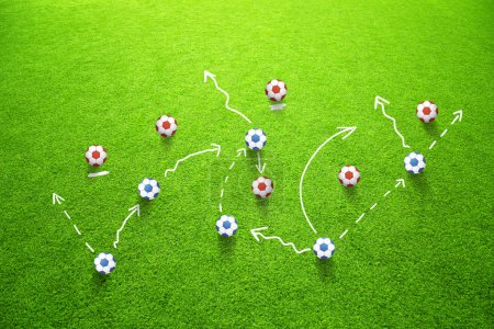 Football strategy game plan with soccer balls