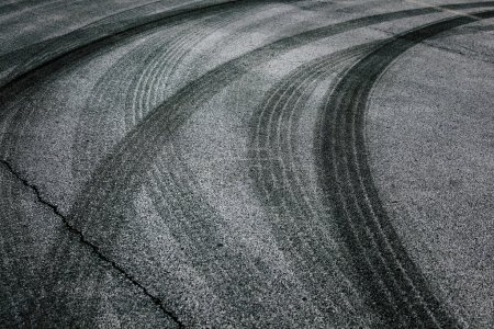 Photo for Abstract asphalt road background with crossing of tires tracks. - Royalty Free Image
