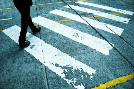 Pedestrian feet road crossing
