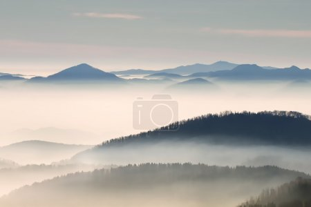 Hill landscape with fog