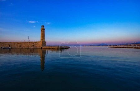 Photo for Magnificent view of Lighthouse and  old port, Retimno, Crete, Greece during a beautiful sunset in the Mediterranean. Love and travel background - Royalty Free Image