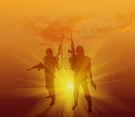silhouette of a soldiers with weapon