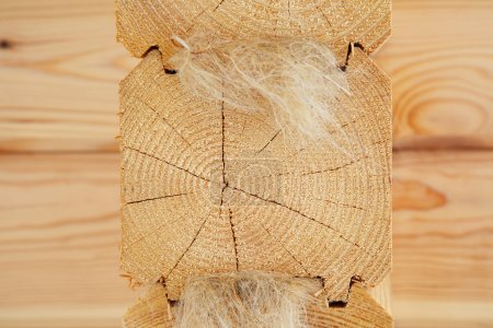 Photo for The end of the profiled beam with fiber insulation - Royalty Free Image