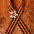 George Ribbon on wooden background and Order of th...