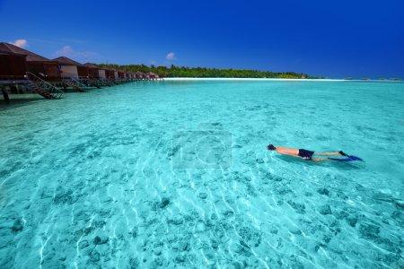 man snorkeling in tropical island