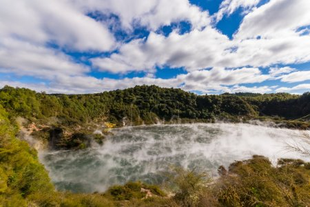 Volcanic crater with steaming lake