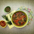 Vegetarian soup with beans mung bean and tomato. Vedic cooking.