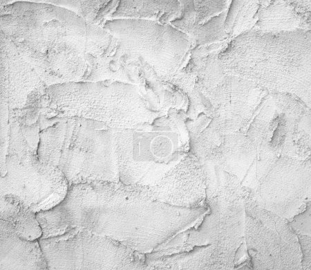 White plaster wall, uneven walls, old industrial b...