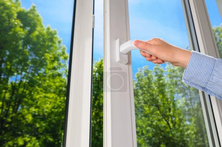 Photo for Open plastic vinyl window on a background blue sky - Royalty Free Image