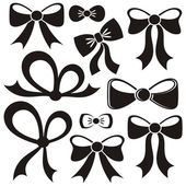Set of different decorative black vector bows isolated